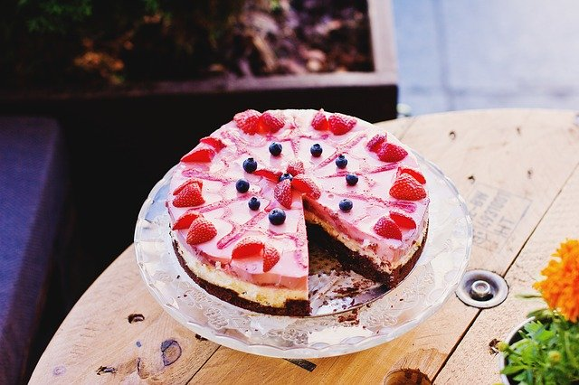 A slice of cake sitting on top of a wooden table